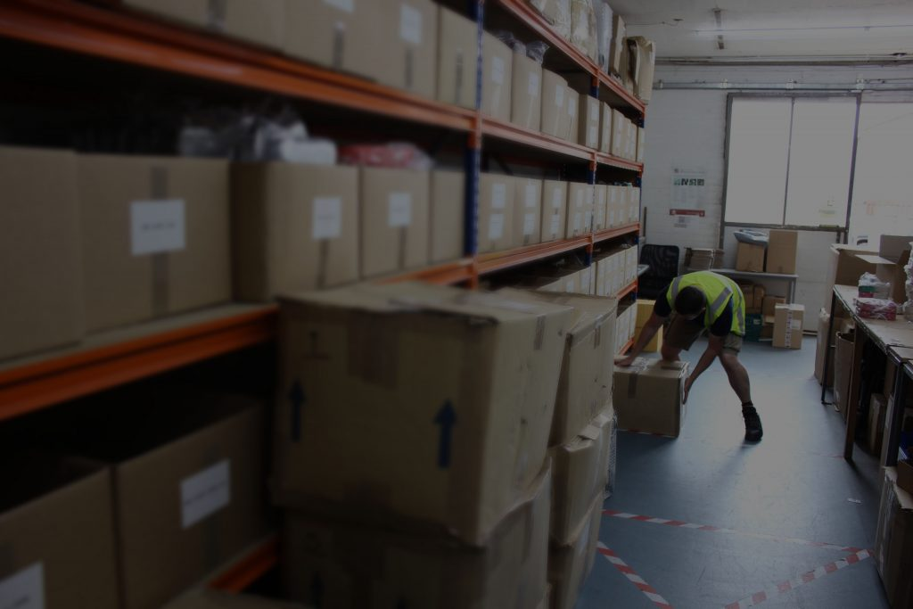 Our talented warehouse staff picking and packing away